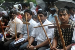 Indian Dalit - untouchable - Christians and Muslims sit in the rain during a protest rally against the National Commission for Scheduled Castes and Scheduled Tribes for its recent rejection of the demand for reservation for Dalit Christians and Muslims, in New Delhi on August 1, 2012.  Thousands of protestors, church leaders, nuns, bishops and priests of the National United Christian Forum demanded that the United Progressive Alliance (UPA) government grant equal rights and reservation for the Dalit Christians and Muslims.   AFP PHOTO/RAVEENDRAN